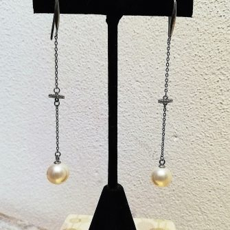 Long Pearl drop earrings with cubic zirconia detail
